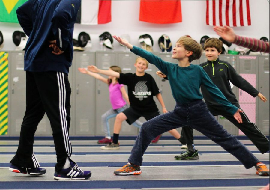 Child in beginning youth fencing class NW Fencing