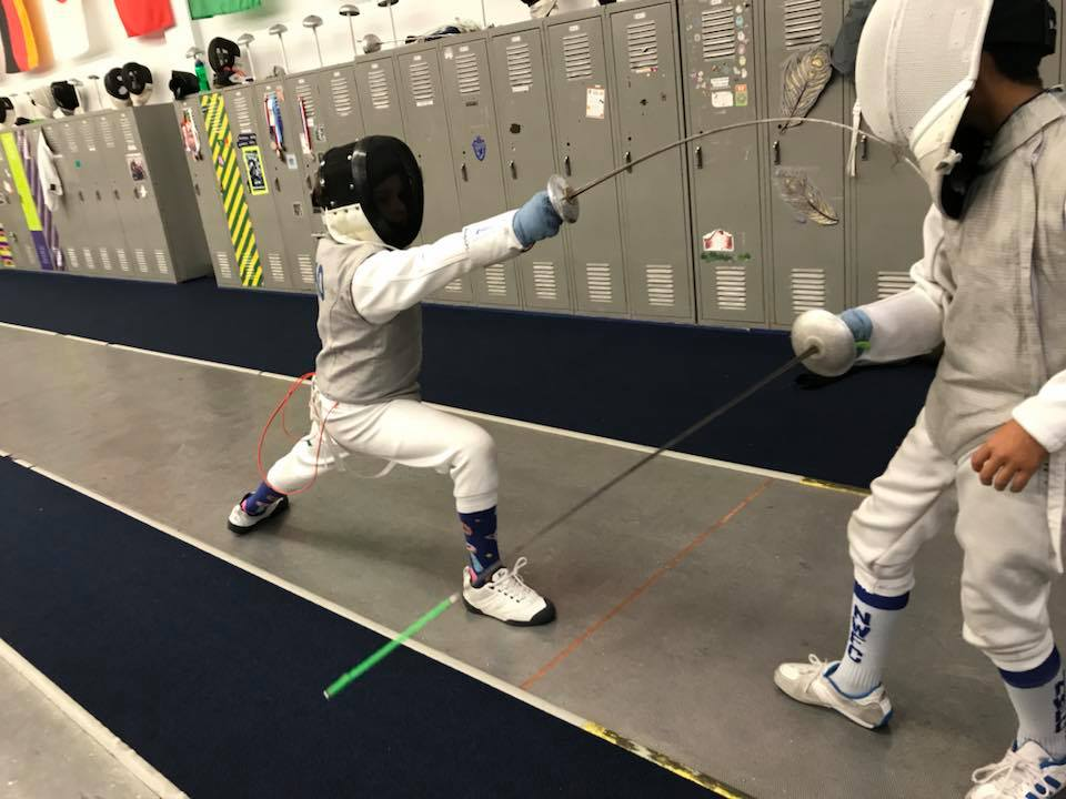 NWFC Beginning Youth Camps learn to fence