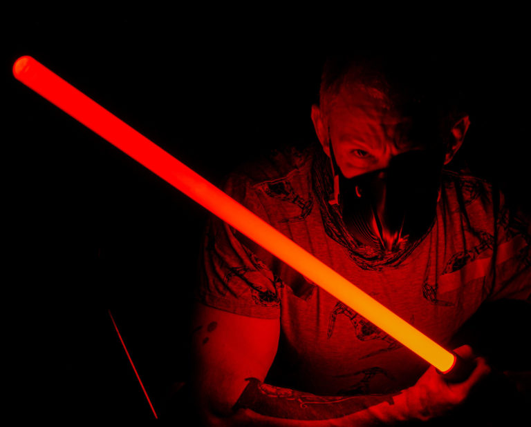 Coach Vince embraces the power of the Dark Side. Photo shoot fun with a red lightsaber adding a dark side touch.